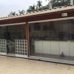Porta de vidro na área gourmet